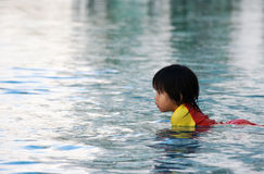 Children play onwater in swimimg pool Stock Image
