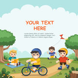 Children play outside. Cute boys read a book, ride a bicycle, play roller skate in the park Royalty Free Stock Photography