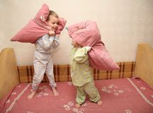 Children play with pillows Stock Photography