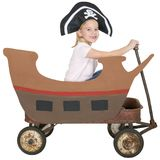 Children Play Pirate, Pretend, Isolated. A young girl plays make believe and is sailing a pirate ship. The toy wagon becomes a vessel of fun on the high seas and Royalty Free Stock Photography