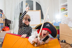 Children play pirates. Children are playing pirates indoors Royalty Free Stock Image