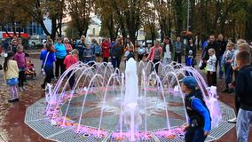 Children play on the playground with fountains stock footage