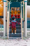 Children play with playground at park stock image