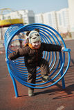 Children play on the playground. Photo of happy children play on the playground Stock Image