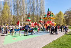 Children play on the playground at the spring park in sunny day Royalty Free Stock Photography