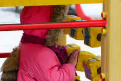 Children play on the playground in the winter Stock Photography