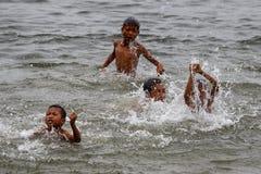 Children Play in Rhi Lake, Myanmar (Burma) Royalty Free Stock Photo