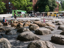 Children play in rock garden outside Harvard Yard. Stock Images