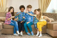 Children play rock paper scissors. Kids in the room Royalty Free Stock Images