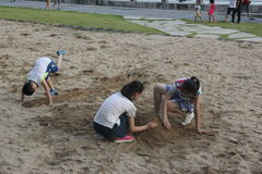 Children play with sand on the seashore in SHENZHEN Royalty Free Stock Image