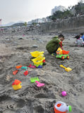 Children play with sand. Use the weekend time, the adults to take children to play in the floodplain of sand Stock Image