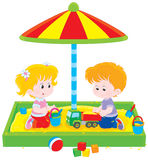 Children play in a sandbox Stock Images