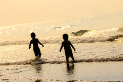 Children play in the sea Royalty Free Stock Photo