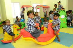 CHILDREN PLAY SEESAW IN MONTISSORI SCHOOL Royalty Free Stock Photography