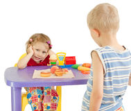 Children play shop. A white background Stock Image