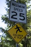 Children at play sign with speed limit. Royalty Free Stock Images