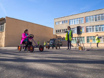 Children play on the site before the school in the organization of traffic Royalty Free Stock Images