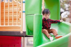 Children play slide playground in the park royalty free stock images