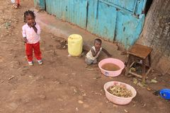 Children play in the slums of Nairobi - one of the poorest places in Africa royalty free stock image