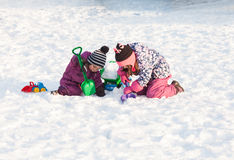 Children play on the snow Stock Photo