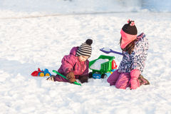 Children play on the snow Royalty Free Stock Photos