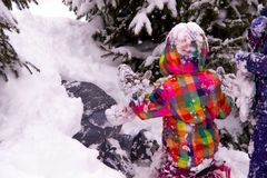 Children play in the snow after heavy snow, mountains of snow stock photo