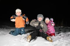 Children play snowblls in the night Stock Images