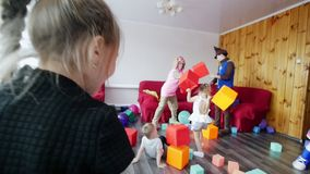 Children play with soft cubes. Animators entertain children. A children`s party. Close up stock footage