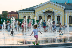 Children play and splash in the city`s fountains in the square. Editorial. 08.03.2017. Children play and splash in the city`s fountains in the square. Ukraine stock images