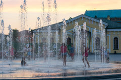 Children play and splash in the city`s fountains in the square. Editorial. 08.03.2017. Children play and splash in the city`s fountains in the square. Ukraine stock photography