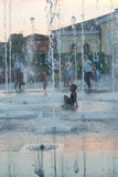 Children play and splash in the city`s fountains in the square. Editorial. 08.03.2017. Children play and splash in the city`s fountains in the square. Ukraine royalty free stock images