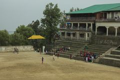 Children play on stadium for sports stock photography