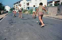 Children play on the street. In the mid 1960s, in a small town in South Germany. stock photo