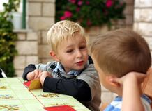 Children play a table game Royalty Free Stock Image