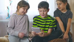 Children play in the tablet two girls and one boy stock video footage