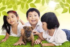 Children play time with dog in spring Royalty Free Stock Image