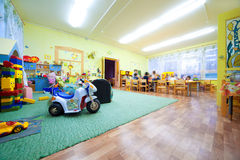 Children play to room where many toys. Stock Photos