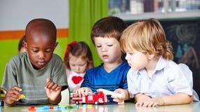 Free Children Play Together In Kindergarten Stock Image - 181531821