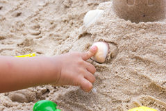 Children play toy on sand. Royalty Free Stock Images