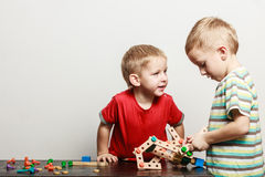 Children play with toy on table. Stock Image