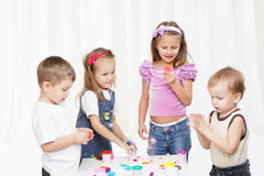 children play with toys against white background Royalty Free Stock Image