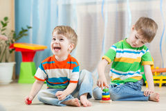 Children play with toys indoor Royalty Free Stock Photo