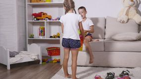 Children play with toys in the room stock video