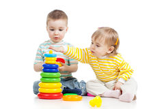 Children play toys together. Children girl and boy playing toys together Royalty Free Stock Photo