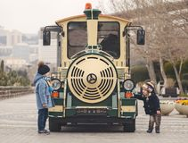 Children play at the train. In the boulevard Stock Photos