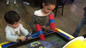 Children Play Video Games Arcade. Shot of Children Play Video Games Arcade stock footage