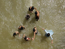 Children play in water. Children who play in the big river meander. Play-province of Denizli, in the village from the river Asagıseyit Sheep Review Contest stock image