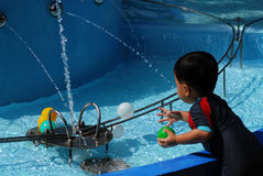 Children play water game Stock Photos