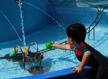 Children play water game Stock Photo