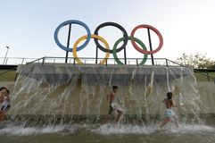 Children play in the water in the Olympic park Stock Photos